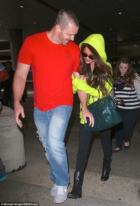 Selena Gomez spends time with her stepdad as they jet home